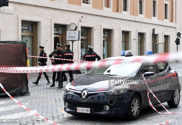 Carabinieri secure the area on the site of a bomb alert on May 23 2018 at the Credito Artigiano bank Via della Conciliazione near the Vatican during...