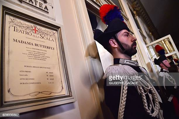 Carabinieri stand guard at la Scala opera house for the Premiere of 'Madame Butterfly' on December 7 2016 in Milan Milan's La Scala opens its 201617...