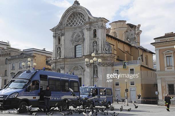 carabinieris guard in front of the damaged Santa Maria del Suffragio' s church in the historic center of the Abruzzo capital L'Aquila on April 9 2009...