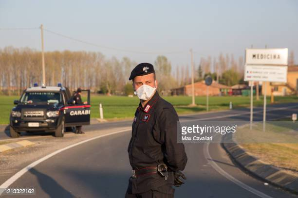Carabinieri's police corp controls the entrance of the town of Medicina on March 18 2020 in Bologna Italy The Italian government continues to enforce...
