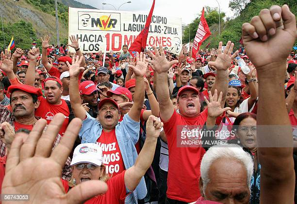 Thousands of supporters of Venezuelan President Hugo Chavez raise their hands 04 February 2006 in Caracas showing the '10 million votes' he needs for...