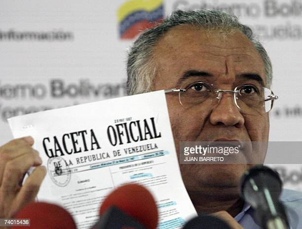 TO GO WITH AFP STORY The Minister of Information and Communications of Venezuela Willian Lara shows during a press conference in Caracas on December...