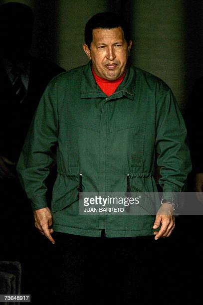 Venezuelan President Hugo Chavez awaits for the arrival of his guest Trinidad Tobago's PM Patrick Mannig 20 March 2007 at the Miraflores presidential...