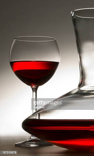 carafe of red wine with wineglass