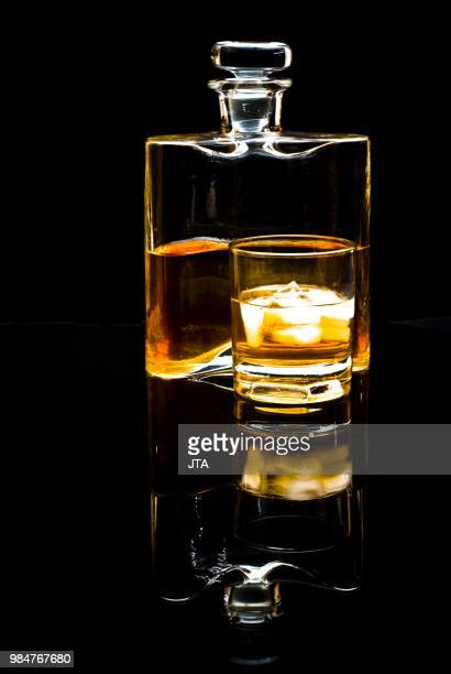 carafe of scotch whiskey or bourbon and drink with ice