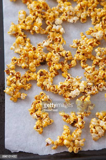 Caramelised popcorn on a baking tray