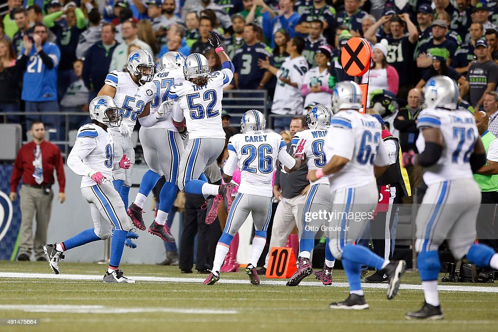 Caraun Reid #97 of the Detroit Lions celebrates with teammates after recovering a fumble by Russell Wilson #3 of the Seattle Seahawks (not pictured) and scoring a touchdown during the fourth quarter of their game at CenturyLink Field on October 5, 2015 in Seattle, Washington.
