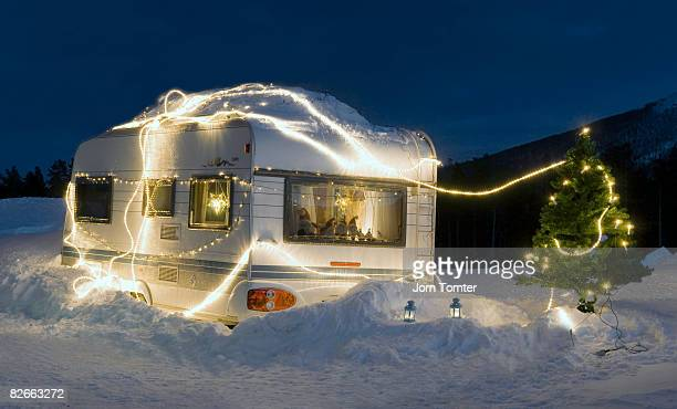 Caravan and Christmas tree decorated with lights