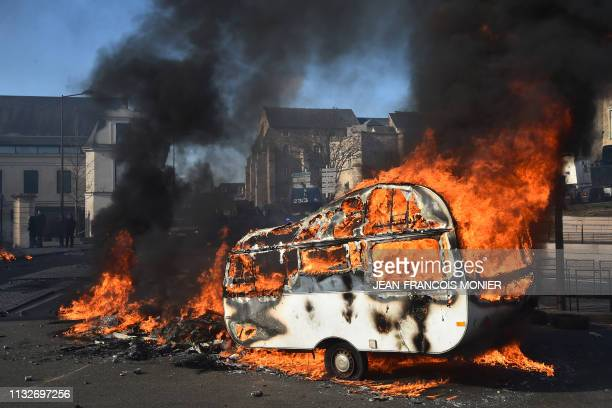 TOPSHOT A caravan has been set on fire as fairground workers clash with gendarmes protecting the access to the city hall as they demonstrate to...