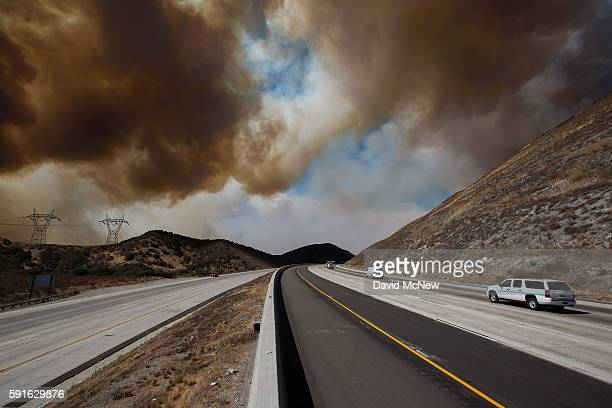 A caravan of emergency vehicles drives the closed down 215 freeway which goes over the Cajon Pass and is the main traffic corridor between Los...