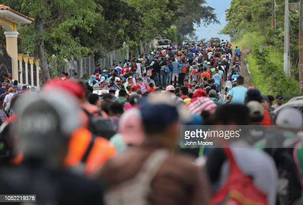 A caravan of more than 1500 Honduran migrants moves north after crossing the border from Honduras into Guatemala on October 15 2018 in Esquipulas...