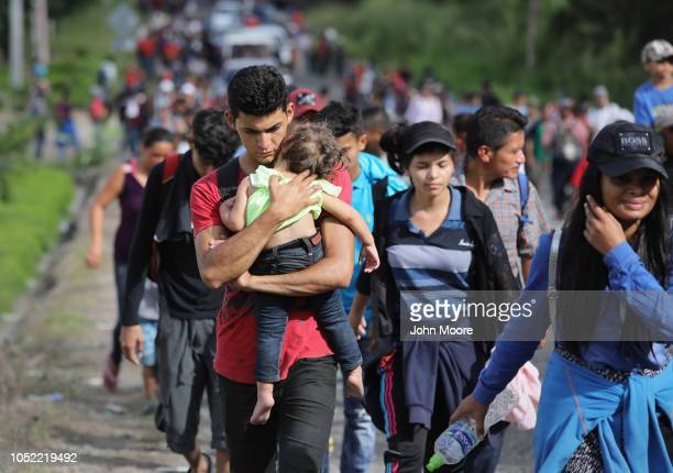 Caravan of more than 1,500 Honduran migrants moves north after crossing the border from Honduras into Guatemala on October 15, 2018 in Esquipulas,...