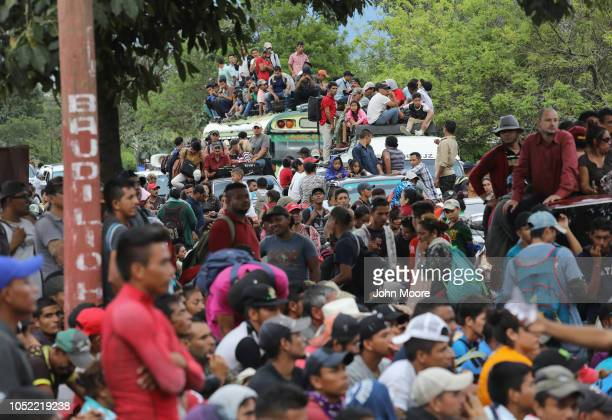 A caravan of more than 1500 Honduran migrants pause after crossing into Guatemala on October 15 2018 in Esquipulas Guatemala The caravan the second...