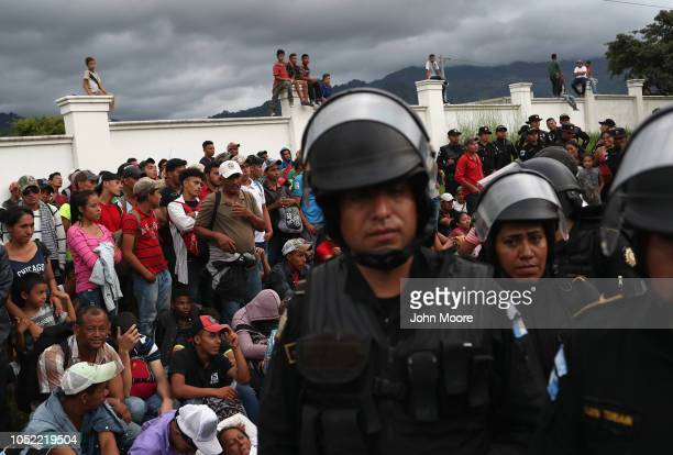 A caravan of more than 1500 Honduran migrants pauses at a Guatemalan police checkpoint after crossing the border from Honduras on October 15 2018 in...