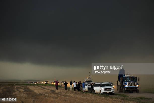 A caravan of storm chasers arrive on the scene of a supercell thunderstorm May 10 2017 in Olustee Oklahoma Wednesday was the group's third day in the...