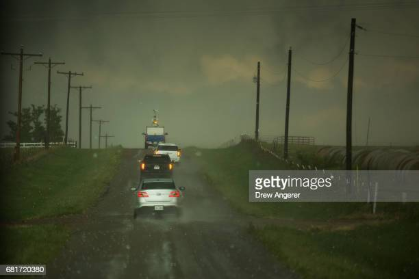 A caravan of storm chasers travels through hail as they chase a supercell thunderstorm May 10 2017 in Olustee Oklahoma Wednesday was the group's...