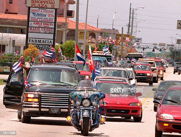 A Caravan of vehicles protest down Flagler Street in Miami FL April 25 2000 Several area businesses staged a strike and closed for the day while...