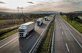 Caravan or convoy of trucks on highway