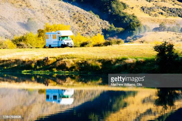 Caravan parked at autumnal Lake Moke campsite, Queenstown, South Island, New Zealand.