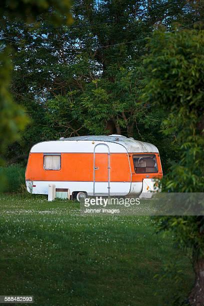 Caravan parked on meadow