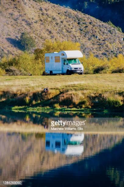 Caravan reflections, Lake Moke campsite, Queenstown, South Island, New Zealand.