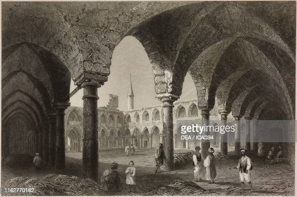 Caravanserai in Acre Israel engraving by J Tingle after a drawing by W H Bartlett from La Siria e l'Asia minore illustrate by Giorgio Briano Turin
