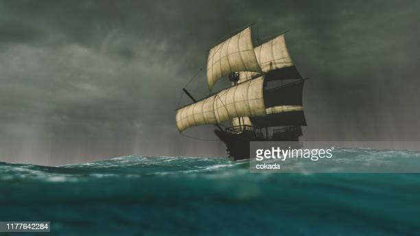 caravel sailing the ocean during a storm - history stock pictures, royalty-free photos & images