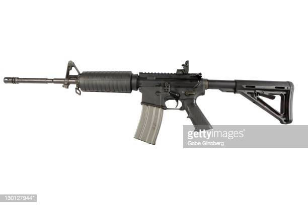 m4 carbine on white background - rifle stock pictures, royalty-free photos & images