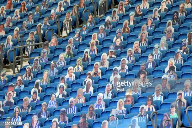 Carboard cut outs of fans are seen in the stands prior to the Premier League match between Brighton Hove Albion and Arsenal FC at American Express...