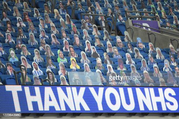Carboard cutouts of fans are seen in the stands with a big thank you to NHS workers written on the hoarding before kick off of the English Premier...