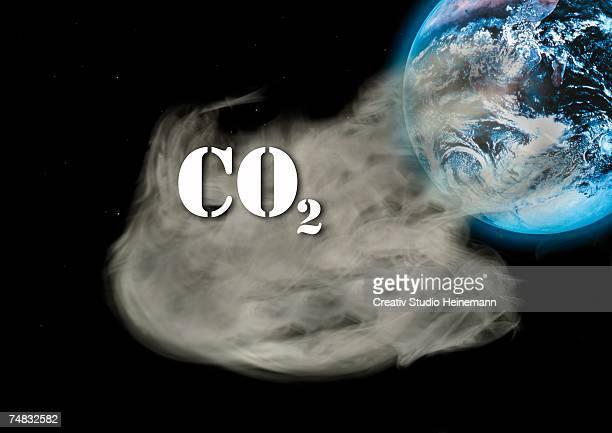 Carbon dioxide emissions and globe, (digital composite)