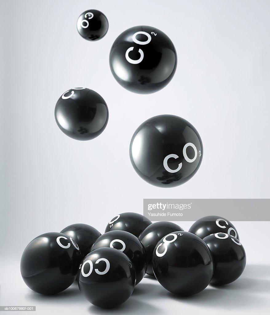 Carbon dioxide molecules falling into heap : Stock Photo