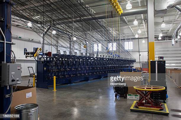 Carbon fiber is loaded onto spools at the SGL Automotive Carbon Fibers manufacturing plant in Moses Lake Washington US on October 9 2013 The US...