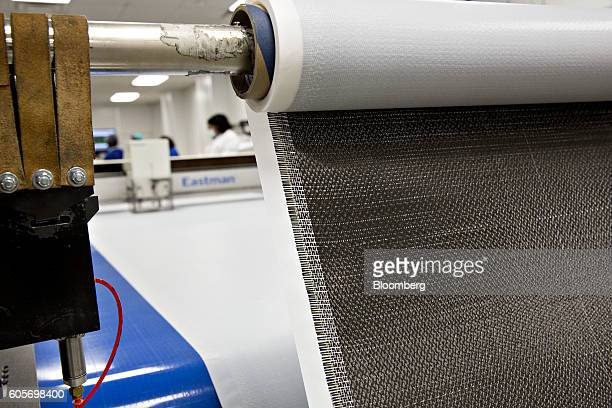 Carbon fiber sheeting is fed into a cutting table at the GE Aviation manufacturing facility in Batesville Mississippi US on Wednesday Sept 7 2016 The...