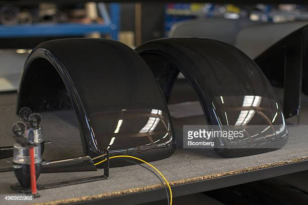 Carbon fibre mudguards for Donkervoort D8 GTO automobiles sit on a table at the Donkervoort Automobielen BV manufacturing facility in Lelystad...