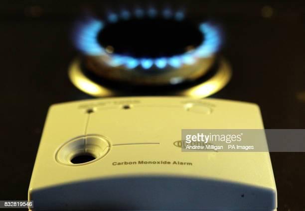 A carbon monoxide sensor unit beside a gas hob ring
