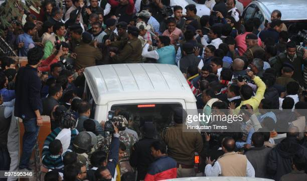 Carcade carrying the former Chief Minister of Bihar Lalu Prasad under police custody with supporters proceeding to Birsa Munda Central Jail after his...