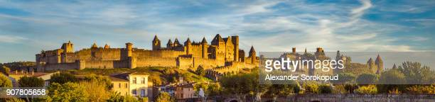 carcassone medieval fortress panoramic view, sunset time, france - carcassonne stock pictures, royalty-free photos & images