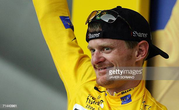 S Floyd Landis celebrates on the podium the yellow jersey as overall leader he retained after the 211.5 km twelfth stage of the 93rd Tour de France...