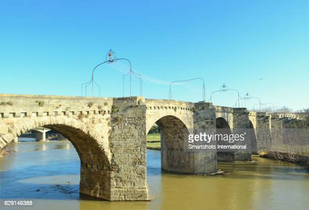 Carcassonne's Old Bridge over Aude river in France, a UNESCO heritage site