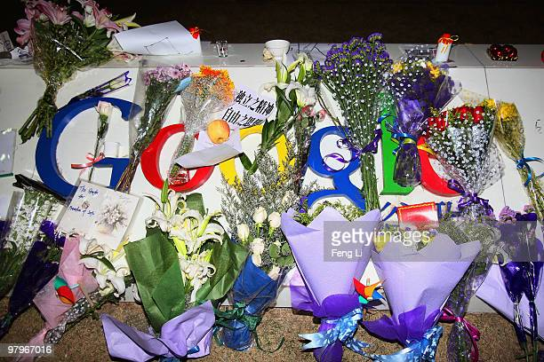 A card a letter and flowers are placed on the Google logo at its China headquarters building on March 23 2010 in Beijing China Google has closed its...