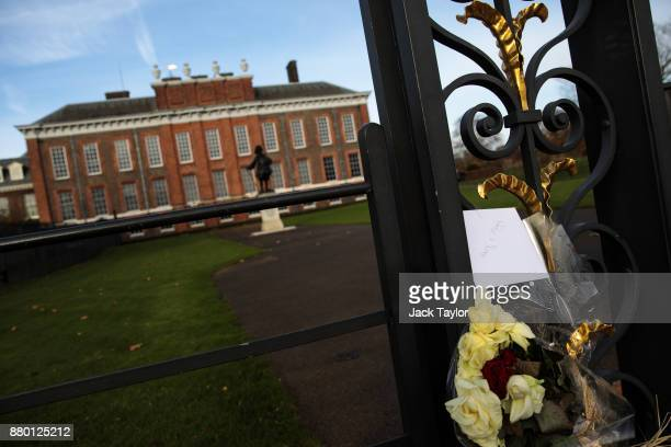 A card addressed Prince Harry and Meghan Markle sits attached to the gates outside Kensington Palace following the announcement of the couple's...