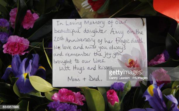 A card and flowers left during a wreath laying ceremony at the Garden of Remembrance in Tundergarth to mark the 20th anniversary of the Lockerbie air...