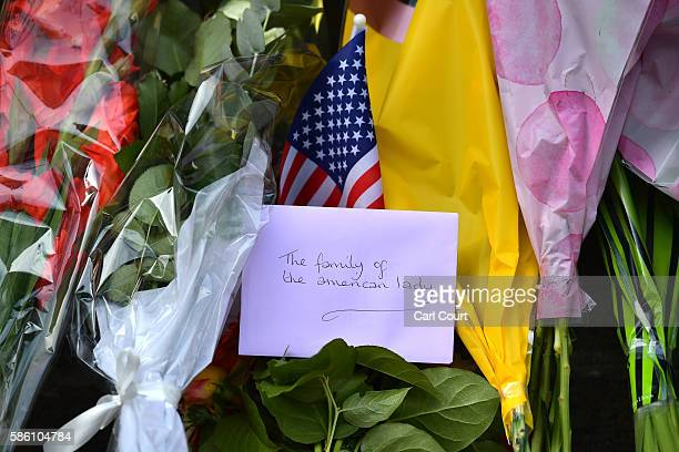A card and US flag is left with flowers at the scene of a stabbing in which one woman was murdered on August 5 2016 in London England Darlene Horton...