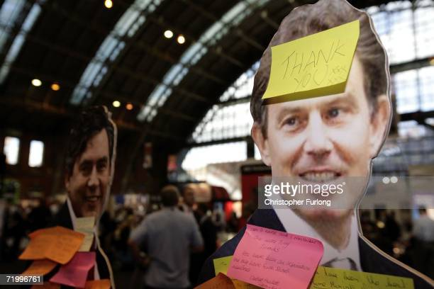 Card board cut outs of Prime Minister Tony Blair and Chancellor Gordon Brown stand on display in the GMEX centre covered in post-it notes on...