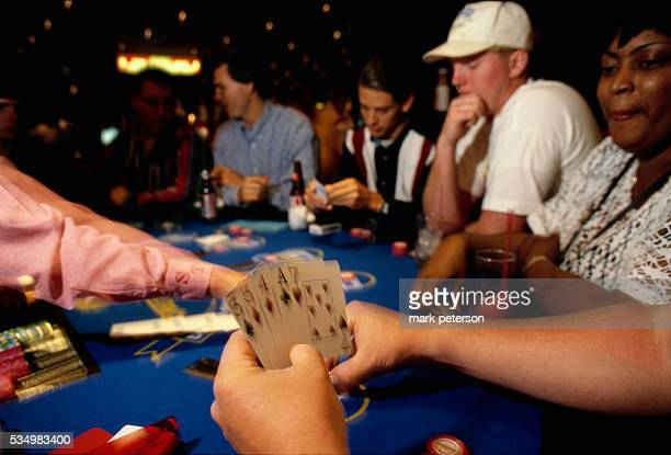 A card dealer deals cards to gamblers during a game of poker in Mississippi