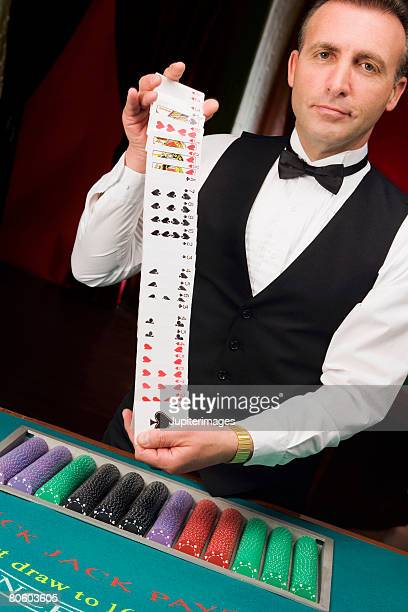 card dealer in casino - shuffling stock photos and pictures