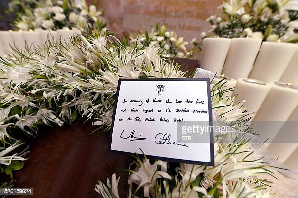 A card displays a message on a wreath laid by Britain's Prince William Duke of Cambridge and Catherine Duchess of Cambridge at a ceremony at the...