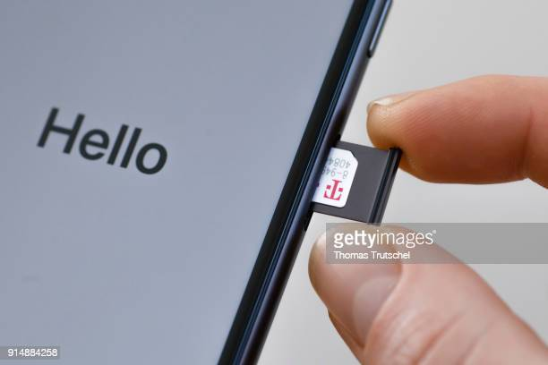 A SIM card from Deutsche Telekom is pushed into a smartphone on February 06 2018 in Berlin Germany