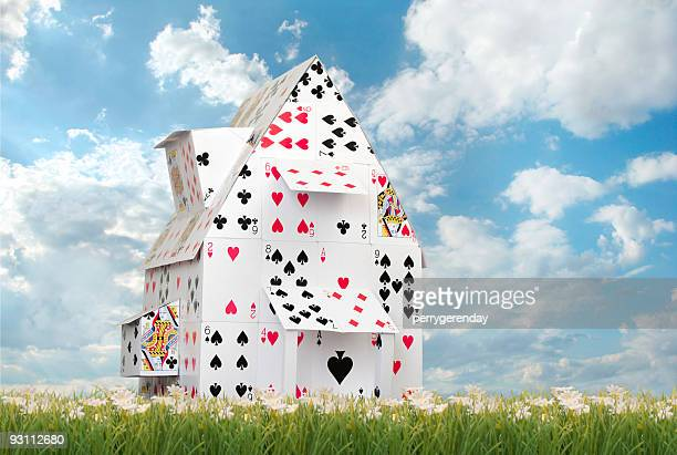Card House Against Blue Skies
